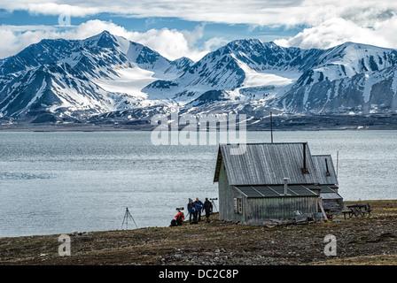 Tourist photographers at Camp Mansfield, an abandoned marble quarry, Blomstrandhalvoya, Spitsbergen,Svalbard Archipelago, - Stock Image