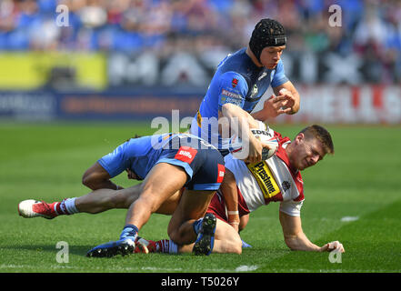 Wigan Warriors' Tom Davies is tackled by St Helens' Regan Grace and Jonny Lomax during the Betfred Super League match at the DW Stadium, Wigan. - Stock Image