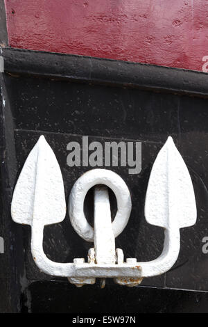 Close up of boat's anchor. White / silver anchors on black hull. - Stock Image
