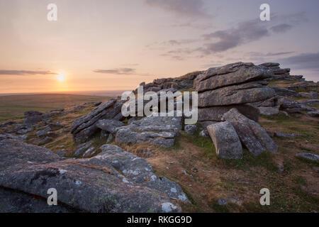 Sunset on Rowtor Dartmoor national park Devon Uk - Stock Image