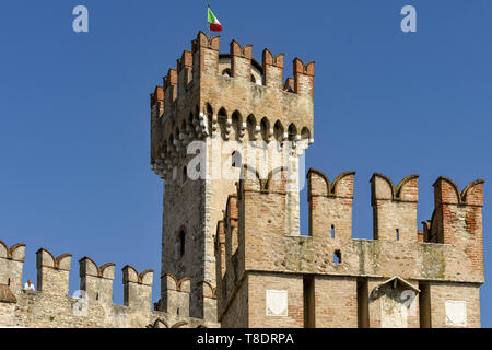 SIRMIONE, LAKE GARDA, ITALY - SEPTEMBER 2018: Scaliger Castle in the lakeside town of Sirmione on Lake Garda. It is a medieval fortress on the edge of - Stock Image