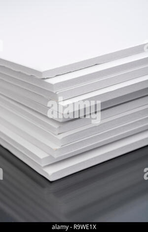 Stack of craft white foam board / Foamboard - used for mounting images, model-making, presentation boards. - Stock Image