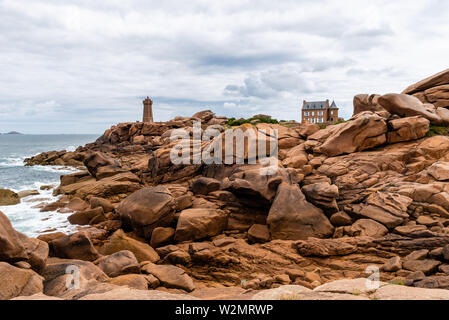 Beautiful rocky landscape in the coast of Brittany, Ploumanac'h lighthouse against sky. - Stock Image