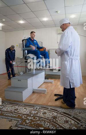 International Space Station Expedition 59 crew member Nick Hague rides the rotating chair testing his vestibular system at the Baikonur Cosmodrome March 7, 2019 in Baikonur, Kazakhstan. Expedition 59 crew: Christina Koch of NASA, Alexey Ovchinin of Roscosmos, and Nick Hague of NASA will launch March 14th onboard the Soyuz MS-12 spacecraft for a six-and-a-half month mission on the International Space Station. - Stock Image
