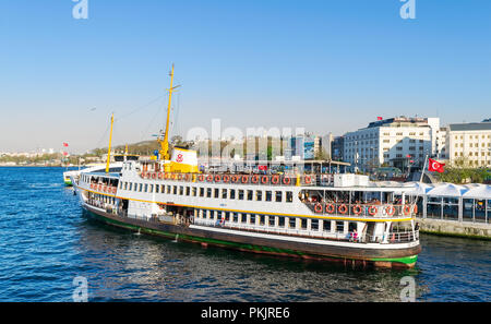 Istanbul, Turkey - April 25, 2017: Local ferry departing Eminonu ferry terminal before sunset - Stock Image