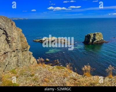 Skerwink trail in Newfoundland showing off beautiful coastal view of rocks and sea - Stock Image