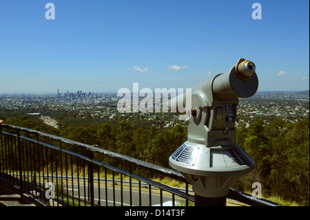 Coin-operated telescope on Mount Coot-tha, Queensland, with city of Brisbane in distance. - Stock Image