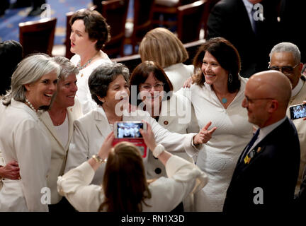 February 5, 2019 - Washington, District of Columbia, U.S. - United States Representative Lois Frankel (Democrat of Florida), third from the left, gestures towards US Representative Ted Deutsch (Democrat of Florida), right, as she poses for a group photo with fellow US Representatives, from left, Katherine Clark (Democrat of Massachusetts), Julia Brownley (Democrat of California), Rep. Frankel, Anne Kuster (Democrat of New Hampshire), and Cheri Bustos (Democrat of Illinois), and Rep. Deutsch prior to US President Donald J. Trump delivering his second annual State of the Union Address to a joi - Stock Image