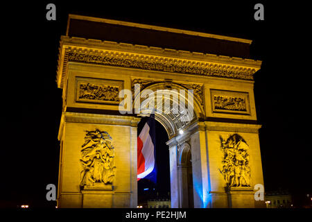 The Arc de Triomphe at night in the Place de Etoille on the Champs Elysses in Paris, France - Stock Image