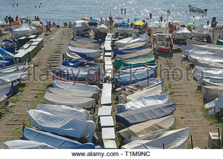 Boats covered at sunny waterfront, Genoa, Liguria, Italy - Stock Image