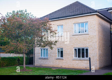 Newly built two floors semi detached apartment house with small garden on the front. England, UK - Stock Image