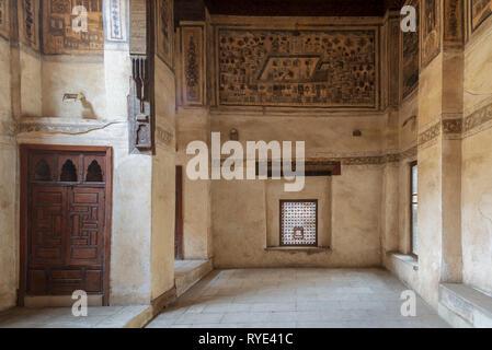 Stone wall with wooden window (Mashrabiya) at ottoman era historic Beit El Set Waseela building (Waseela Hanem House), Old Cairo, Egypt - Stock Image