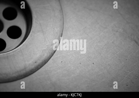Clos-up of a metal kitchen sink and drain / plug hole - Stock Image