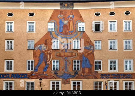 Anker building decorated with painted sundial, Waagplatz square, Salzburg, Austria - Stock Image
