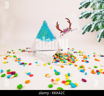Christmas decoration triangle git box with candies for celebration best Christmas holidays background image for - Stock Image