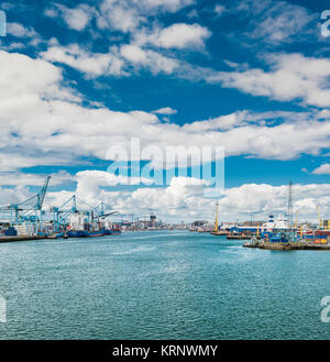 View up the River Liffey towards Dublin City Centre, from ferry ship about to dock in Dublin Port, Ireland - Stock Image