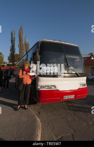 Azerbaijan, Sheki (Shaki), bus depot, bus to Baku, with people - Stock Image