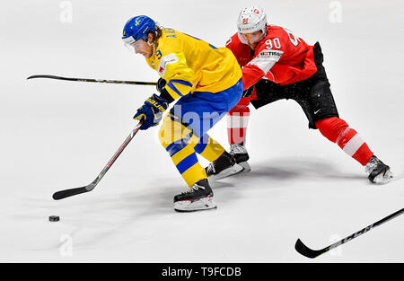 Bratislava, Slovakia. 18th May, 2019. From left hockey player of Sweden ADRIAN KEMPE and ROMAN JOSI of Switzerland in action during the match Sweden against Switzerland within the 2019 IIHF World Championship in Bratislava, Slovakia, on May 18, 2019. Credit: Vit Simanek/CTK Photo/Alamy Live News - Stock Image