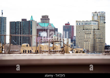 Manhattan skyline with the Watchtover sign seen from the Brooklyn Bridge. - Stock Image