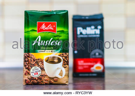 Poznan, Poland - March 9, 2019: German Melitta Auslese coffee in a 250 gram package on a wooden table. - Stock Image