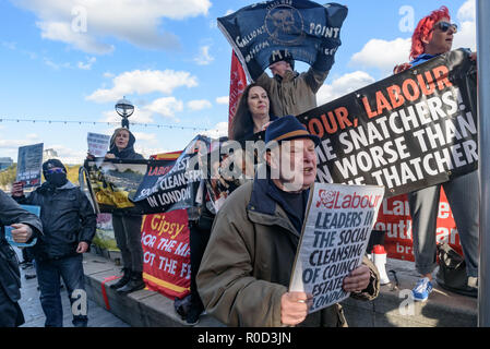 London, UK. 3rd November 2018. Class War supporters came to the 'No Demolitions Without Permission' housing protest at City Hall with banners declaring that Labour Councils were the biggest social cleansers in London and 'Labour, Labour Home Snatchers! Even Worse Than Maggie Thatcher', pointing out that it was largely Labour councils who were demolishing council estates so that developers could replace council houses with large numbers of properties sold at high market prices and a miserably small number of homes at social rent, promoting schemes which cut by thousands the number of council ho - Stock Image