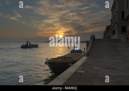 a boat docked at Dawn in Venice - Stock Image