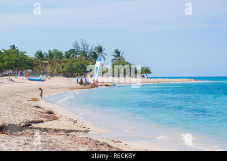 Beautiful white sand and blue ocean in the beach scene from Cuba. - Stock Image