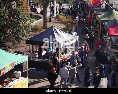 Busy food market with stalls for Indian, German and many more types of food for sale - Stock Image