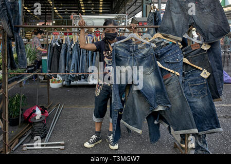 Denim jeans for sale at a Thailand market - Stock Image