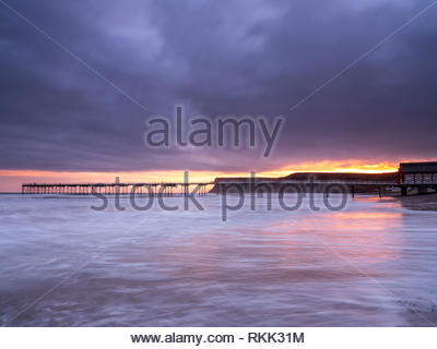 Saltburn-by-the-Sea. 12th Feb 2019. Weather: Sunrise silhouettes the Pier on the coast at Saltburn-by-the-Sea on the north-east coast. 12th February 2019. © Gary Clarke/Alamy Live News - Stock Image