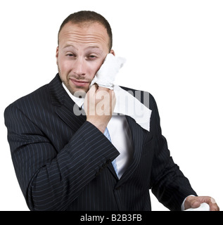 businessman cleaning his face on isolated background - Stock Image