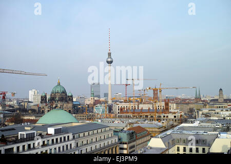Schlossplatz construction site from distance. Humboldt Box, TV Tower and Berliner Dom are visible, panoramic view. - Stock Image