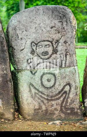 Stone carved with petroglyph (ca. 1270s), Caguana Indian Ceremonial Park, Utuado, Puerto Rico - Stock Image