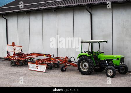 Agricultural vehicles. Tractor Deutz D 6207 and rake Kuhn GA 6622. - Stock Image