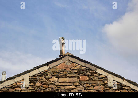 Exterior of a stone house, Bowness, Lake District National Park, Cumbria, England, UK - Stock Image