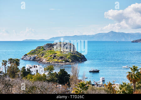 Beautiful landscape view of rabbit island, sea and boats from above in Gumusluk, Bodrum, Mugla, Turkey. - Stock Image
