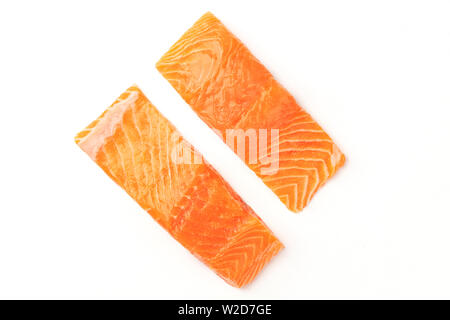 An overhead photo of two slices of salmon on a white background with copy space - Stock Image