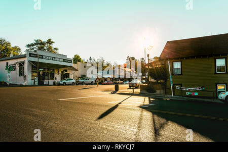 Pedestrian crosses the street in the historic small town of Julian in California. - Stock Image