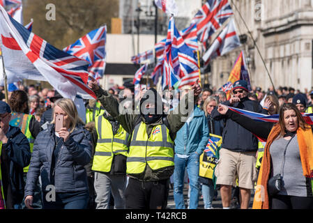 'We want our country back', protesters gathered in Parliament Square outside the Houses of Parliament in Westminster angry at the UK not having yet left the European Union. Demonstrators feel that the UK government is not complying with the democratic vote of 17.4 million people, with many threatening violence should the poll vote not be complied with - Stock Image