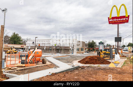 HICKORY, NC, USA-3/14/19: A remodeling takes place on an older McDonald's restaurant building.  Construction workers visible. - Stock Image