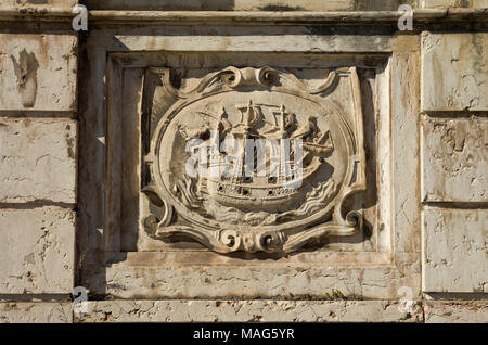 Left low relief panel of Kings fountain monument (Chafariz Del Rei) portraying a ship. The Kings fountain was built in the XIII century and rebuilt in - Stock Image