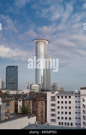 A mix of modern and traditional architecture, with Westendstrasse 1 tower block and residential housing in the foreground, Frankfurt am Main, Germany. - Stock Image