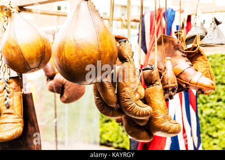 Leather boxing gloves, boxing gloves, boxing speed ball, antique boxing gloves, antique boxing gear, old boxing - Stock Image