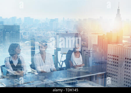 Businessmen that work together in office. Concept of teamwork and partnership. double exposure - Stock Image