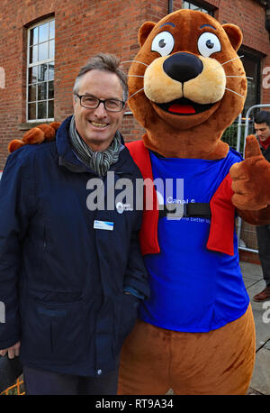 Richard Parry and Ollie the Otter at Dukes 92  Richard Parry is the chief executive of  the Canal and River Trust while Ollie the otter is a mascot. - Stock Image
