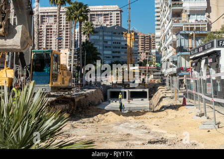 Local council and engineers in La Cala, Alicante province, Spain instal culverts to channel flood waters under the streets during flash floods - Stock Image