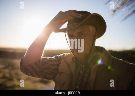 Portrait of man in hat on a sunny day - Stock Image