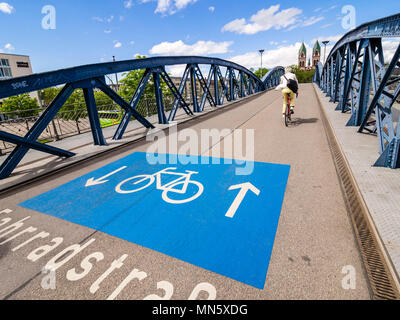 Bicycle-only road, Fahrradstrasse, on bridge Wiwilíbrücke,Wiwilíbridge, blue bridge, Stühlingerbridge, Herz-Jesu church, Freiburg, Breisgau, Baden-Wür - Stock Image