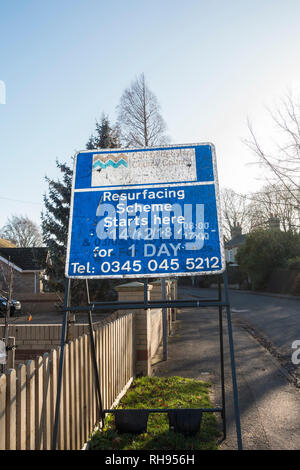 Cambridgeshire county council road sign advising of road resurfacing for one day - Stock Image