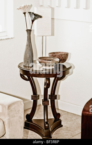 Vase with bowls on a stool - Stock Image
